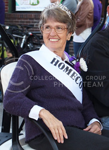 Erma Karr Riley, K-State Homecoming Queen in 1965, rides through Aggieville in the Homecoming Parade on Oct. 16, 2015. (Miranda Snyder | The Collegian)