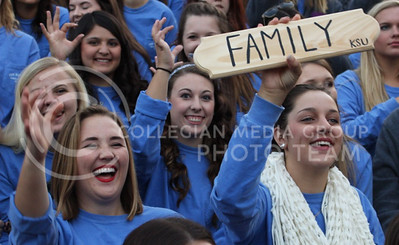 Kristen Jones (left), sophomore in civil engineering and Molly Mason (right), freshmen in pre-vet cheer with their Kappa Delta sorority sisters during the pep rally at the Larry Norvell Band Shell in City Park on Oct. 16, 2015. (Miranda Snyder | The Collegian)