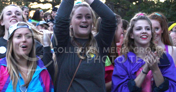 Jess Zidek (left), junior in industrial engineering, Guin Toalson (center), senior in elementary education and Kaley Brungardt (right), junior in biological engineering cheer during the pep rally as awards are presented for homecoming week activities at the Larry Norvell Band Shell in City Park on Oct. 16, 2015. (Miranda Snyder | The Collegian)