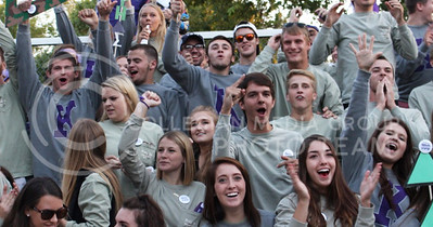 Members of Delta Delta Delta, Farmhouse and Delta Sigma Phi cheer during the Pep Rally at the Larry Norvell Band Shell in City Park on Oct. 16, 2015. (Miranda Snyder | The Collegian)