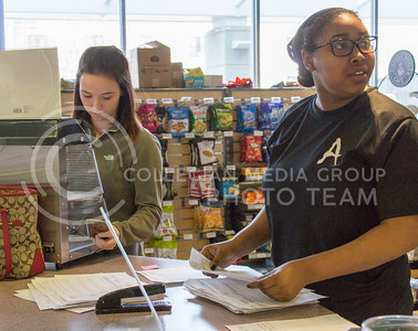 Amber Cockrell, junior in pre-dental, and Ebony Williams, senior in psychology, sort through paperwork at the Kat's Den on Feb. 15, 2016. Both Cockrell and Williams are still working in the K-State Student Union during the construction and employee transition. (EvanAnn Boose | The Collegian)