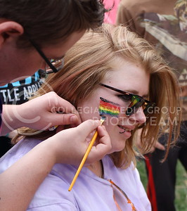 Jackie Platt, Manhattan resident, gets her face painted at the annual Little Apple Pride festival in City Park on April 17, 2016. (Miranda Snyder |  The Collegian)