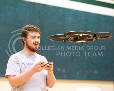 Tony Williams, senior in mass communications and physics, flys a Parrot AR Drone in the gymnasium of Eisenhower Middle School on Tuesday March 29, 2016. Williams is enrolled in MC 589 - Issues in Mass Communications where the subject is drones in journalism. (Photo by Evert Nelson | The Collegian)