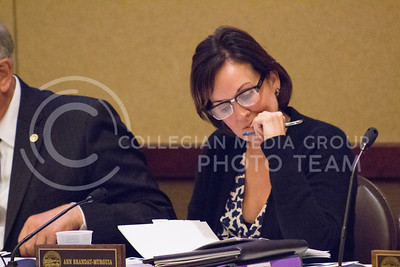 Ann Brandau-Murguia, member of the Kansas Board of Regents, listens to presentations during Wendnesday's meeting Wednesday.