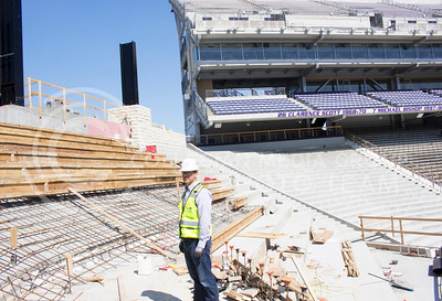 Jeremy Neiderwerder, project manager for Phase IIIB of Bill Snyder Family Stadium Master Plan, looks over the area where new seating area will be constructed in the coming months during a tour May 5, 2016. (Shelton Burch | The Collegian)