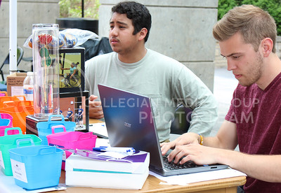 Edson Ibarra, junior in kinesiology, and Andrew Nation , junior in athletic training help Pi Kappa Phi raise money for the 2016 War of Roses event in Bosco Plaza on April 26, 2016. (Jessica Robbins | The Collegian)