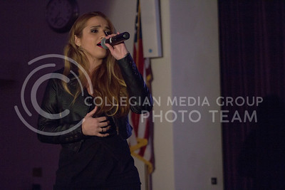 "Ellen Gusmao, international student in civil engineering, performs ""Stone Cold"" by Demi Lovato at UPC's K-State The Voice in the Student Union Ballroom on Saturday, April 9. (Clayton Kistner 