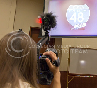 Lacy Siefkin, senior in jounalism, captures the moment at the kickoff of the K-State 48 Hour Film Festival in Town Hall on March 31, 2016. When the video guidelines were revealed, teams had 48 hours to film and edit a short film. (Kaitlyn Heier | The Collegian)