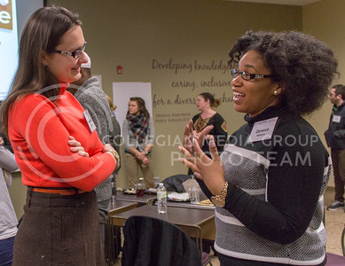 Oleksandra Sopova, graduate student in computer science, shares her definition of leadership with Zenova Williams, graduate student in human ecology during the Graduate Student Leadership Development Program on Feb. 10, 2016, in the Staley School of Leadership Studies Building. (EvanAnn Boose | The Collegian)