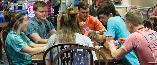Attendees of the Kappa Kappa Gamma and Delta Sigma Phi philanthropy eat their ice cream at the Kappa Kappa Gamma house on April 3, 2016. The philanthropy benefitted Reading is Fundamental. (Kaitlyn Heier | The Collegian)