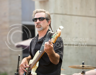 Mike Herman, KSU associate dean of the graduate school, plays the bass guitar for the Red State Blues Band in the Bosco Student Plaza on Aug. 25, 2015. (Emily Starkey | The Collegian)