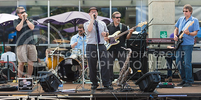 The Red State Blues Band performs original blues compositions, including a song about headed to the 'Ville on a Friday night, during the band's performance Tuesday afternoon on Bosco Plaza. (Parker Robb | The Collegian)