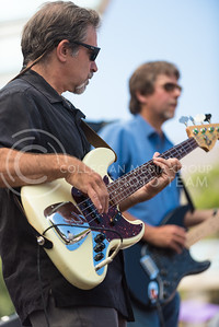Mike Herman, Red State Blues Band bassist, and John Blair, the band's guitarist, play some blues riffs during the band's performance Tuesday afternoon on Bosco Plaza. (Parker Robb | The Collegian)