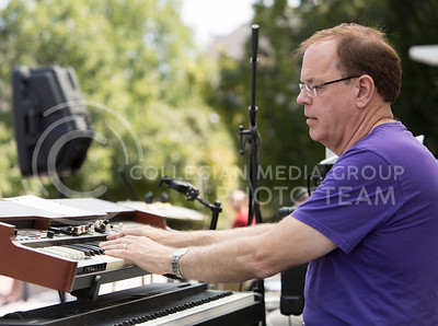 Steve Dyer, electrical and computer engineering professor, plays the keyboard for the Red State Blues Band in the Bosco Student Plaza on Aug. 25, 2015. (Emily Starkey | The Collegian)