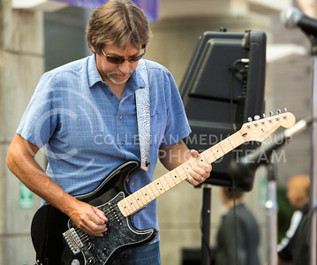 Biology professor John Blair plays the electirc guitar for the Red State Blues Band in the Bosco Student Plaza on Aug. 25, 2015. (Emily Starkey | The Collegian)