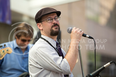 Seth Galitzer, KSU Systems Coordinator of the Computing & Information Sciences Department, sings vocals for the Red State Blues Band in the Bosco Student Plaza on Aug. 25, 2015. (Emily Starkey | The Collegian)