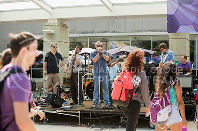 The Red State Blues Band welcomes back students on their way to classes in the Bosco Student Plaza on Aug. 25, 2015. (Emily Starkey | The Collegian)