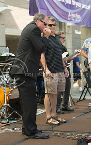 Brian Niehoff, associate provost of institutional effectiveness, joins the Red State Blues Band playing the harp in the Bosco Student Plaza on Aug. 25, 2015. (Emily Starkey | The Collegian)
