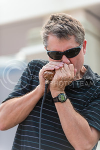 Walter Dodds, the band's harmonica player, gets into the grove as he plays a solo into a specialized harmonica microphone during the band's performance Tuesday afternoon on Bosco Plaza. (Parker Robb | The Collegian)