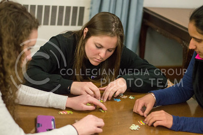Left to right: Cynthia Bressler, sophomore in criminology, Alison DelNegro, junior in kinesiology, and Simrun Hundal, sophomore in english and international studies practice the strength of strategic thinking by putting together their puzzle for the Strengths Carnival in Putnam on March 1, 2016. (Jessica Robbins | The Collegian)
