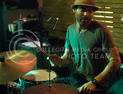 """Suspicious Package drummer Todd Spreer plays """"Doses & Mimosas"""" at the The Varsity Truck during Live Music In The Alley on Aug. 28, 2015. (Emily Starkey 