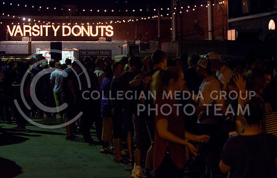 The crowd lines up for doughnuts and entertainment at the The Varsity Truck during Live Music In The Alley on Aug. 28, 2015. (Emily Starkey | The Collegian)