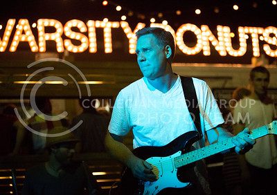 Kevin Peirce, owner of Bluestem Bistro and guitar player for Suspicious Package plays at the The Varsity Truck during Live Music In The Alley on Aug. 28, 2015. (Emily Starkey | The Collegian)