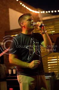 Jeremy Platt, vocals for the band Suspicious Packages, sings at the The Varsity Truck during Live Music In The Alley on Aug. 28, 2015. (Emily Starkey | The Collegian)