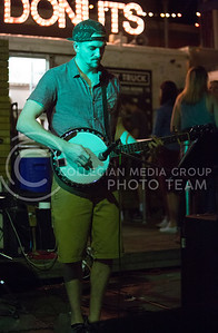 The After Hours ganjo player Brooks Boyce plays at the The Varsity Truck during Live Music in the Alley on Aug. 28, 2015. (Emily Starkey | The Collegian)