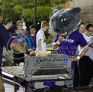 Willie the Wildcat watches the pancakes cook during the Week of Welcome pancake feed at Memorial Stadium on Aug. 29, 2015. (George Walker | The Collegian)