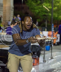 D.J. Johnson, senior in entrepreneurship, catches a pancake during the Week of Welcome pancake feed at Memorial Stadium on Aug. 29, 2015. (George Walker | The Collegian)
