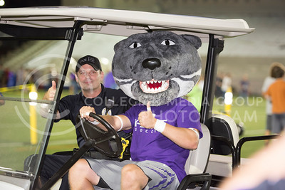 Willie the Wildcat gets in a golf cart with KSU police officer Michael Boller during the Week of Welcome pancake feed at Memorial Stadium on Aug. 29, 2015. (George Walker | The Collegian)
