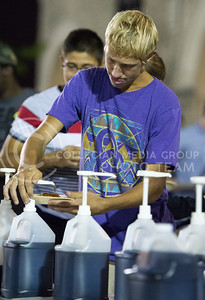 Wesley Crow, freshman in music education, puts syrup on his pancakes during the Week of Welcome pancake feed at Memorial Stadium on Aug. 29, 2015. (George Walker | The Collegian)