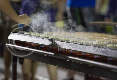 Pancakes cook during the Week of Welcome pancake feed at Memorial Stadium on Aug. 29, 2015. (George Walker | The Collegian)