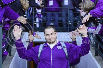 K-State senior offensive lineman Cody Whitehair slaps hands with K-State fans as he walks onto the field at  the K-State Alumni Center Liberty Bowl Pep Rally in AutoZone Park in Memphis, Tennesse, January 1, 2016. (Parker Robb | The Collegian)