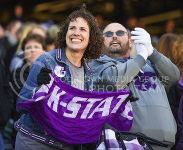 K-State fans rock back and forth to the Wabash Cannonball at  the K-State Alumni Center Liberty Bowl Pep Rally in AutoZone Park in Memphis, Tennesse, January 1, 2016. (Parker Robb | The Collegian)