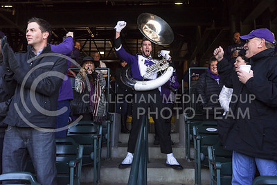 A lone tubist from the K-State Marching Band pumps up part of the crowd during the K-State Alumni Center Liberty Bowl Pep Rally in AutoZone Park in Memphis, Tennesse, January 1, 2016. (Parker Robb | The Collegian)