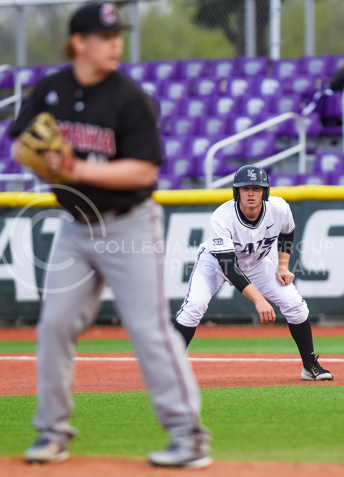 Senior catcher Tyler Moore leads off first base as he awaits the pitch from Nebraska-Omaha pitcher Brett Sasse in the second inning of the Wildcats' 11-3 victory over the Mavericks Mar. 29, 2016, in Tointon Family Stadium. The 'Cats snapped their seven-game losing streak with the victory, and moved to 12-13 on the season. (Parker Robb | The Collegian)