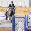 Junior hunter Alison Brunner attempts to jump over multiple fences at once on Oct. 9, 2015 at Timbercreek Stables in Manhattan.  KSU lost to OSU 13-7.  (Rodney Dimick | The Collegian)