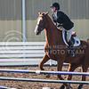 Junior hunter Henley Adkins begins a jump with her horse Janus on Oct. 9, 2015 at Timbercreek Stables in Manhattan.  KSU lost 13-7 against OSU.  (Rodney Dimick | The Collegian)