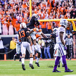 Oklahoma State players celebrate after sealing their come-from-behind victory over K-State after grabbing an interception following a go-ahead field goal with seconds left in the fourth quar ...