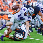 Senior wide reciever turned impromptu quarterback Kody Cook dodges a tackle from Oklahoma State linebacker Seth Jacobs in the third quarter of the Wildcats' heartbreaking 34-36 loss to No. 2 ...