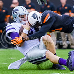Junior quarterback Joe Hubener slides forward as he tries to avoid Oklahoma State safety Tre Flowers in the first quarter of the Wildcats' heartbreaking 34-36 loss to the No. 20-ranked Cowbo ...