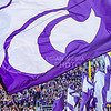 A K-State yell leader waives a flag bearing the powercat after the Wildcats took a 34-33 lead late in the fourth quarter of their heartbreaking 34-36 loss to No. 20-ranked Oklahoma State Oct. 3, 2015, in Boone Pickens Stadium in Stillwater, Oklahoma. (Parker Robb | The Collegian)