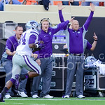 The K-State bench jumps for joy as junior runningback Charles Jones runs by for a gain of 72 yards after receiving a pass from junior quarterback Joe Hubener in the fourth quarter of the Wil ...