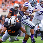 Redshirt freshman runningback Justin Silmon sidesteps Oklahoma State defensive tackle Motekiai Maile as he rushes in the third quarter of the Wildcats' heartbreaking 34-36 loss to No. 20-ran ...