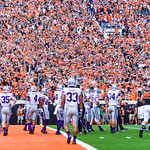 Oklahoma State fans wave their arms back and forth as the band plays one of the school's fight songs before the teams line up for the extra point following the Cowboys' first touchdown in th ...