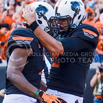 Oklahoma State quarterback Mason Rudolph (right) congratulates wide reciever Brandon Sheperd after the Cowboys took the lead from the Wildcats with Sheperd's fourth-quarter touchdown catch O ...
