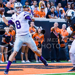 Junior quarterback Joe Hubener looks to throw a pass from the endzone as he is chased down by Oklahoma State defensive end Jimmy Bean late in the fourth quarter of the Wildcats' heartbreakin ...