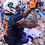 Oklahoma State wide receiver Brandon Shepard catches a touchdown pass before K-State seniordefensive back Morgan Burns can interfere to give the Cowboys a 33-28 lead over the Wildcats in the ...